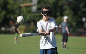 Blind Athlete Hitting Baseball