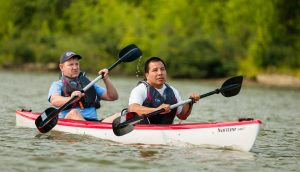Blind Athlete and Guide Rowing in a Kayak
