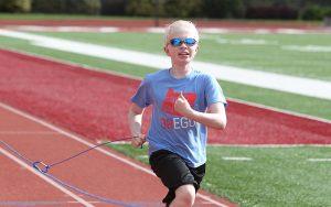 Blind Athlete Running on Track