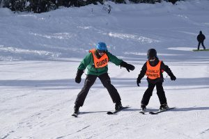 Blind Child Learning to Ski with NWABA Guide