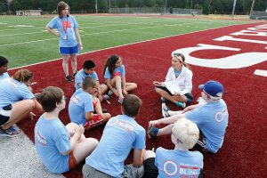 Camp Counselor Talking to Athletes