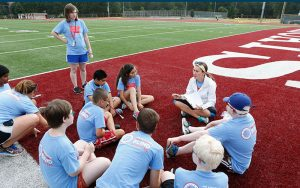 NWABA Athletes Discussing Activities on Football Field