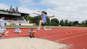 Visually Impaired Athlete in Mid Air Long Jump
