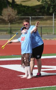 Visually Impaired Athlete Throwing Spear