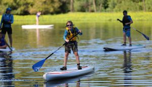 Visually Impaired Child Riding Stand Up Paddle Board