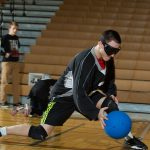 Blind Goalball Athlete Throwing Blue Ball