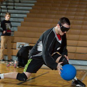 Blind Goalball Athlete Throwing Blue Ball