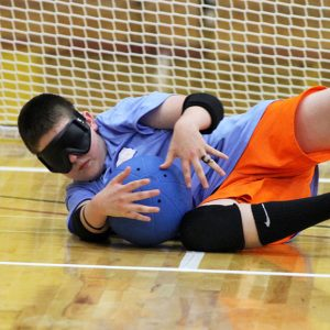 Young Athlete Blocking Goalball Shot