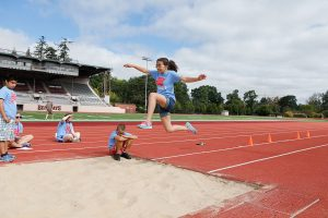 Young Girl in Mid Air Long Jump at Camp Abilities Oregon