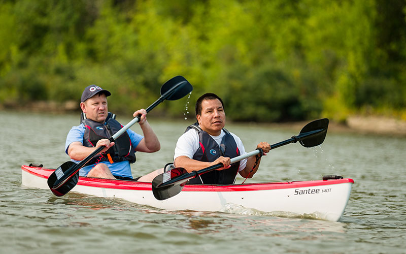 NWABA Guide and Visually Impaired Man in Kayak