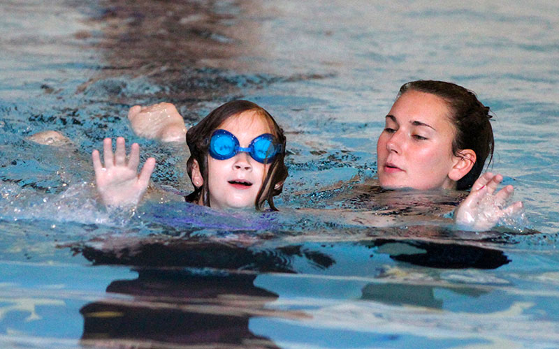 Two visually Impaired Athletes in Swimming Pool