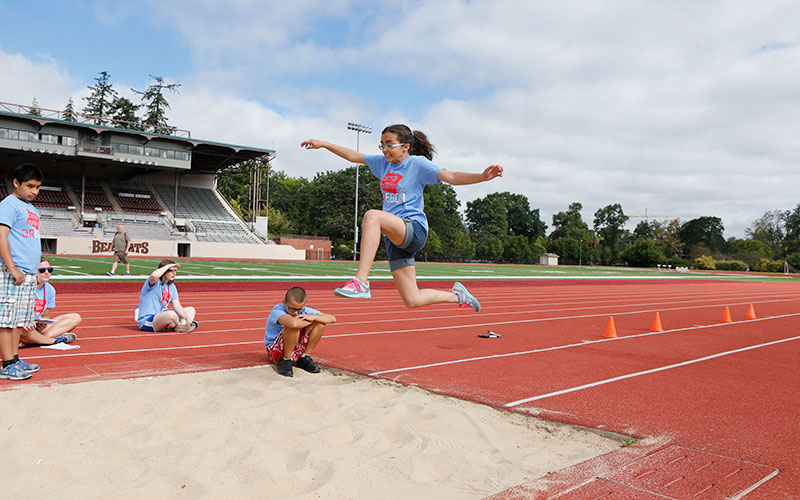 Young NWABA Athlete in Mid Air Long Jump