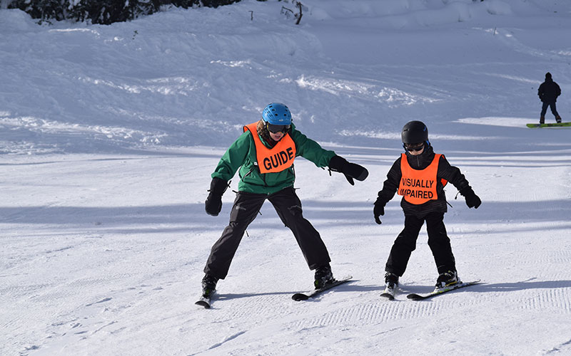 Young Visually Impaired Skier with NWABA Guide