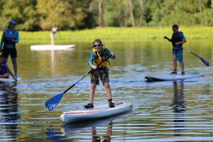 Athlete participateing in stand up paddle boarding