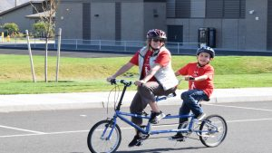 Athlete and volunteer tandem cycling at an NWABA in Eastern Washington
