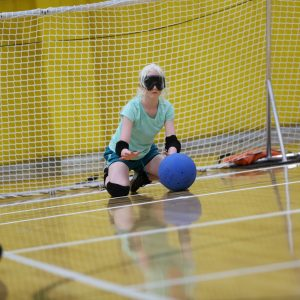 Camper blocking the ball in goalball.