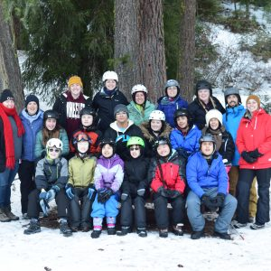 Group of athletes, volunteers, and staff who attended first winter ski camp