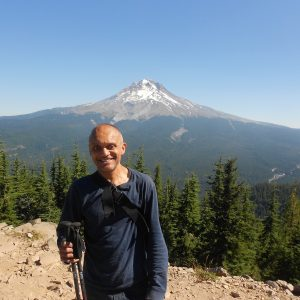 Prateek, NWABA Athlete, smiling at viewpoint with mountain in background
