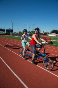 Tandem bicycling on a track